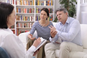 couple consults talking to psychologist